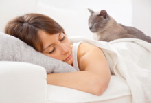 8 Reasons Why Your Cat Likes Sleeping on You