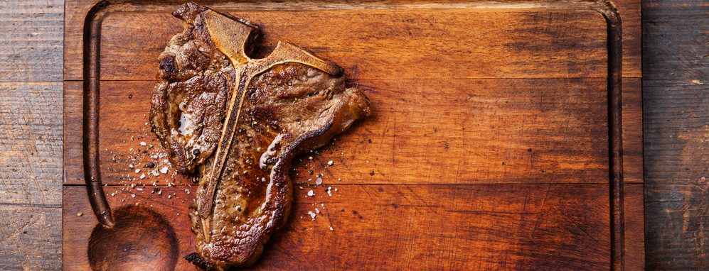 t bone steak on a wood e1582806218790