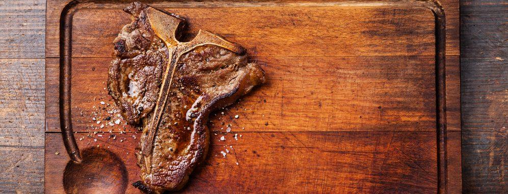 t bone steak on a wood e1582806218790